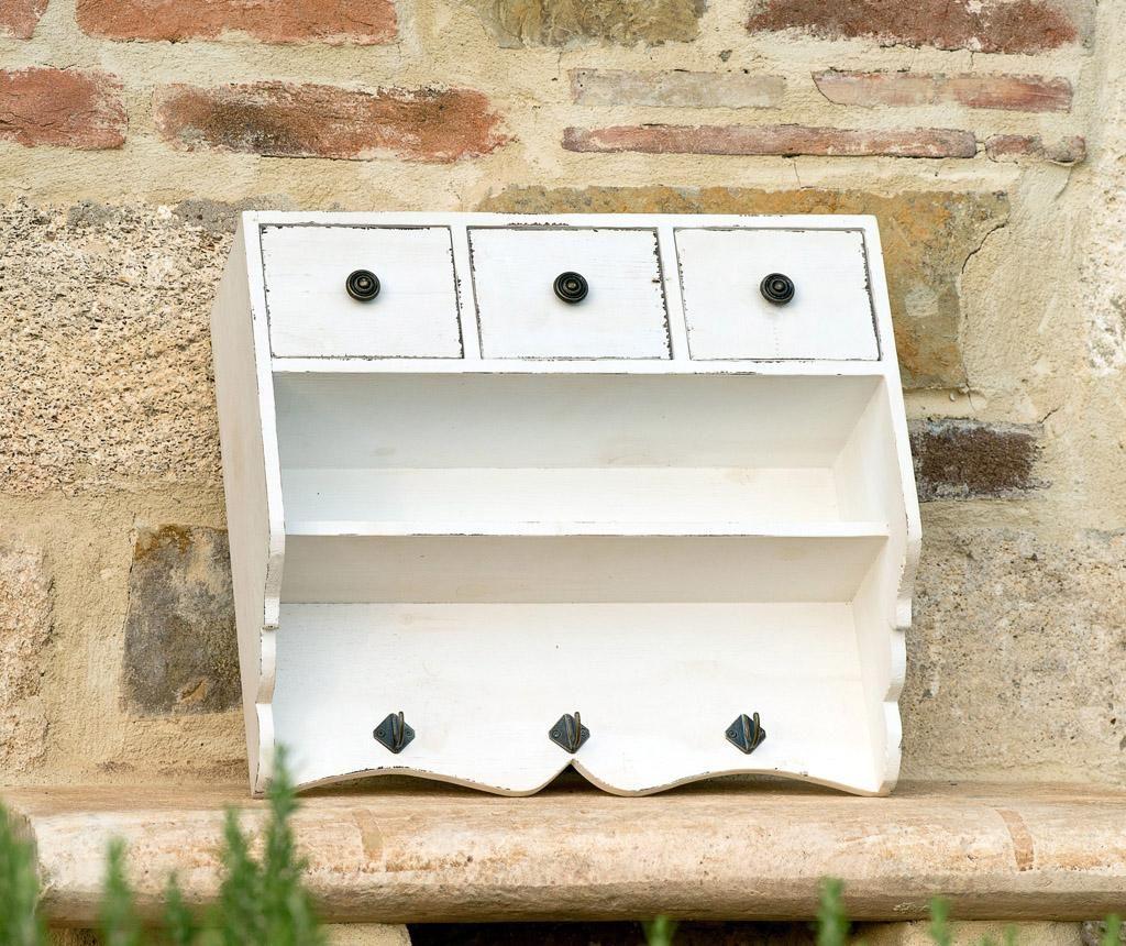 Egy kis konyhaszekrény. Szintén meghatározó darab a vidéki stílusú terekben. A kis akasztókra bögrék kerülnek majd.